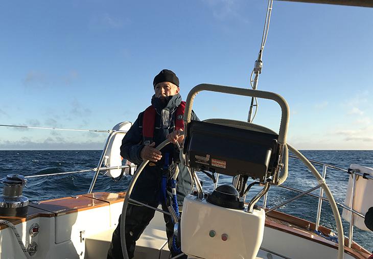 Captain Dan at the Helm of Windwalker II